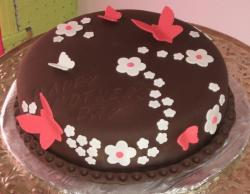 Chocolate cake with floral cake decoration with pink butterflies.JPG