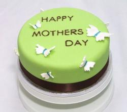 Modern mother's day cake in bright green with white butterflies cake decor.JPG