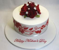 White and red mothers day cake with floral prints and red roses as cake topper.JPG