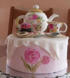 Beautiful tea party cake theme perfect for mother's day cake with pink cake with printed hot pink flowers and tea sets cake topp