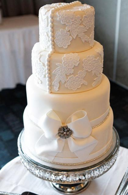 4 Tier Ivory Wedding Cake With Fl Design On Top 2 Tiers Plus White Bow Jpg
