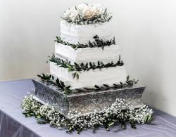 Square 3 Tier White Wedding Cake with Green Leaves & White Roses Topper.JPG