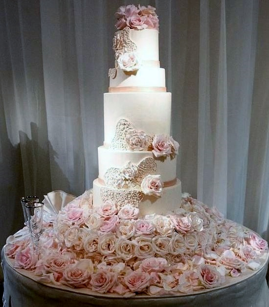 5 tier wedding cake with roses 5 tier wedding cake rising from mound of fresh pink roses jpg 10480