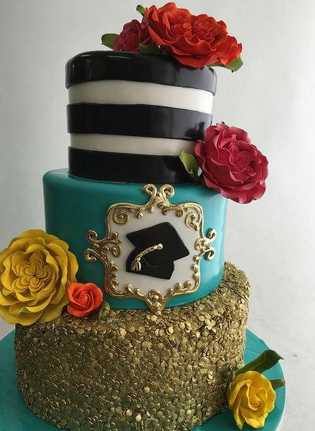 Fancy graduation cake with three tiers with beautiful golden cake decor and cake flowers.JPG