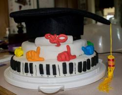 Homemade graduation cake with music theme and large graduation cake topper.JPG