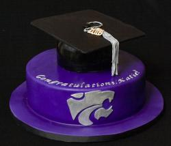 Purple graduation cake with large graduation hat cake topper.JPG