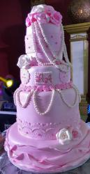 Pink Wedding Cake in 4 Tiers with Pearl Necklaces and Roses.JPG