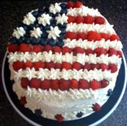 Pretty July of 4th cake decorated with berries into US flag.JPG