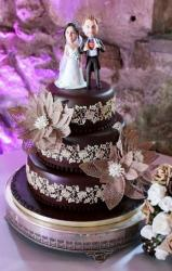 Chocolate 3 Tier Wedding Cake with Realistic Bobblehead Faced Figurines as Toppers.JPG