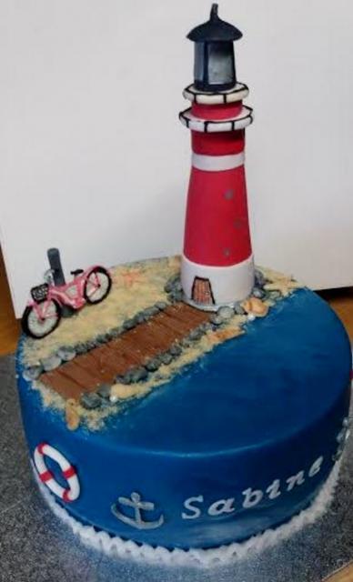 Lighthouse Cake With Pink Bike On Beach Nautical Theme