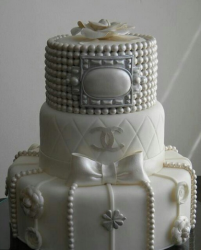 White wedding Chanel cake with pearls cake decoration.PNG
