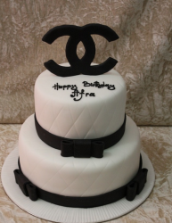 White and Black Chanel cake with large Chanel log cake topper in black.PNG