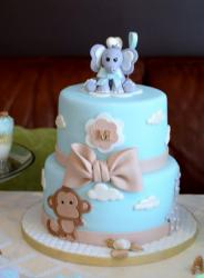 Cute Light Blue Baby Shower Cake in 2 Tiers with Baby Elephant on Top and Monkey on bottom.JPG