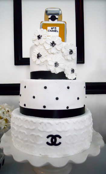 Chanel wedding cake with beautiful cake flowers and Chanel perfume cake topper.PNG