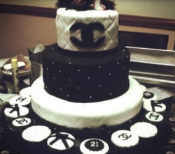 Three tiers Chanel cakes with cup cakes with chocolate and vanilla flavors.PNG