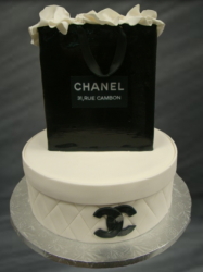 White Chanel cake and black Chancel shopping bag cake topper.PNG