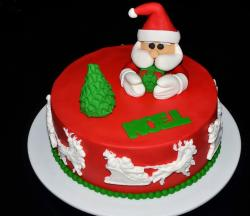 Cute Red Christmas Cake with Santa Holding Present.JPG