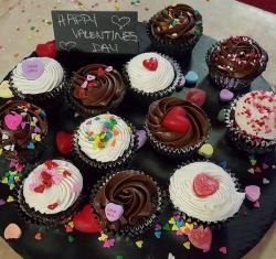 Chocolate Valentines Day cupcakes with candies cake decor.JPG
