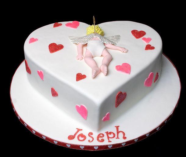Cake Decor Hearts : HEart shaped cake with cupid cake decor and small hearts.JPG