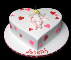 HEart shaped cake with cupid cake decor and small hearts.JPG