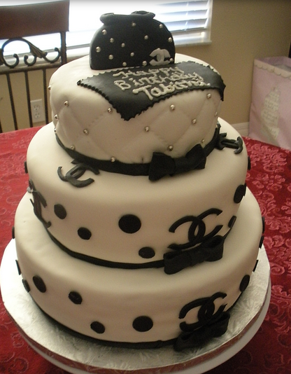 Three tier Chanel cake in white and black.PNG
