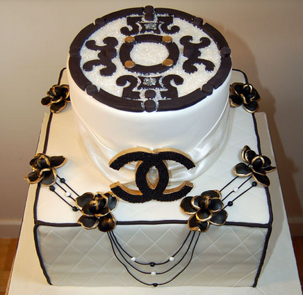 White Chanel cake with black flowers cake decor.PNG