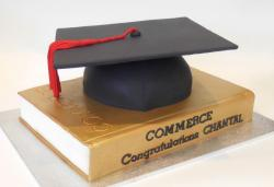 Book graduation cake with graduation hat cake topper