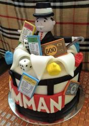 Monopoly theme Cake with Cards Money and Man in Top Hat.JPG
