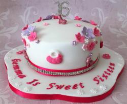 Sweet 16 Birthday Cake with Flowers High Heel Shoes and The Number 16 as Topper