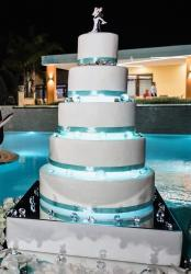 Huge 6 Tier Wedding Cake with Realistic Bride Groom Topper in Embrace