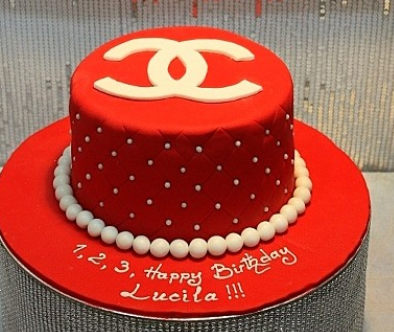 Red Chanel cake with white pearls cake decor