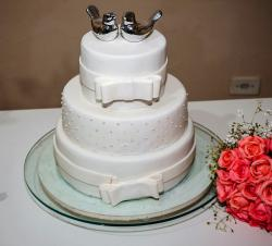White 3 Tier Wedding Cake with Bows & Metallic Love Birds Toppers