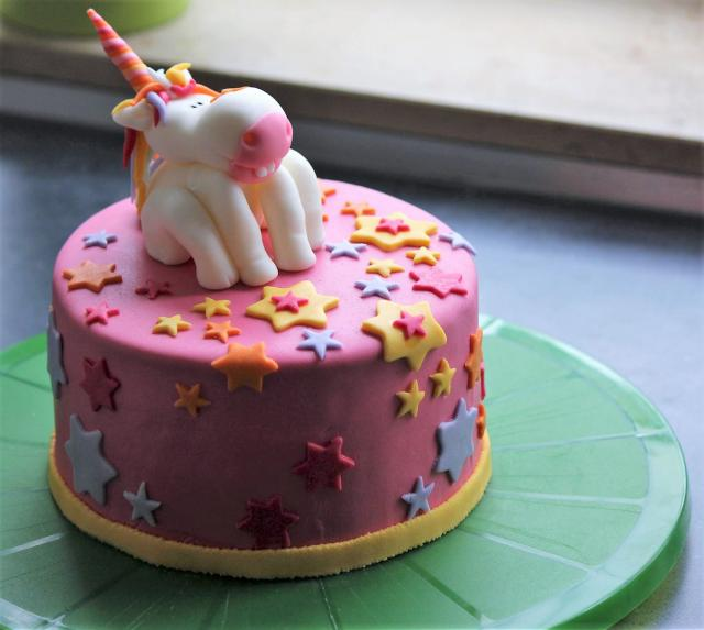 Pink Cake with Cute Unicorn Topper