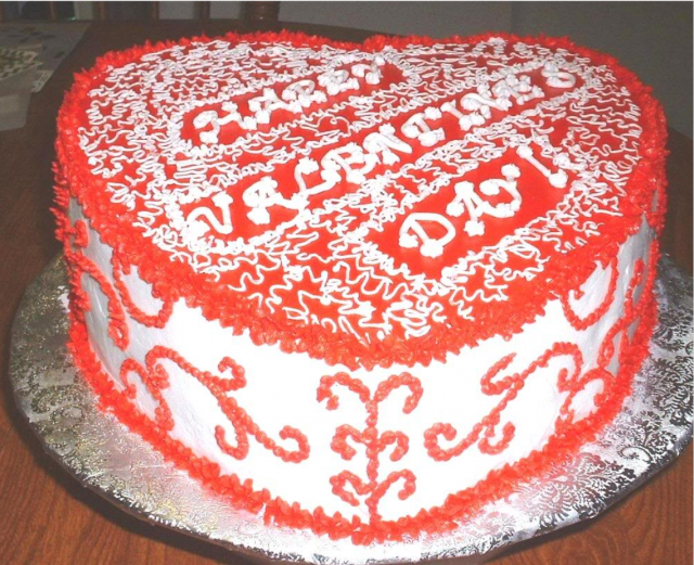 White and red heart shaped valentine cake photos.PNG