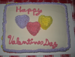 Big valentine cake with colorful cake decor.PNG