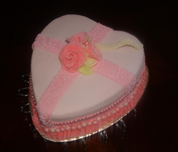 Christian valentine cake in peach pink in heart shape.PNG