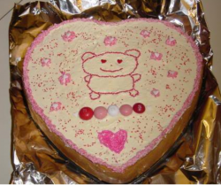 Heart shape valentine cake with cute cake decor with hearts and teddy bears.PNG