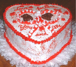 Photo of white valentine cake with red patterns.PNG