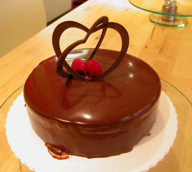 Rich chocolate valentine cake with chocolate heart shape topper.PNG