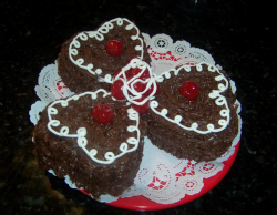 Small heart chocolate valentine cakes with white lines.PNG