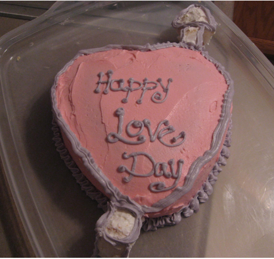 Valentine cake homemade in light pink with purple patterns.PNG