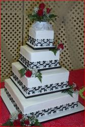 Square tower white wedding cake with roses.jpg