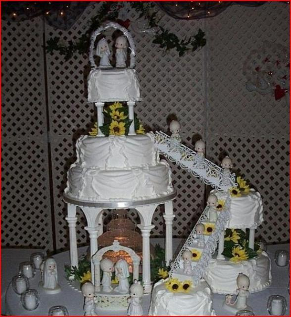 of Staircase wedding cake w/ plentiful baby toppers + fountain decor