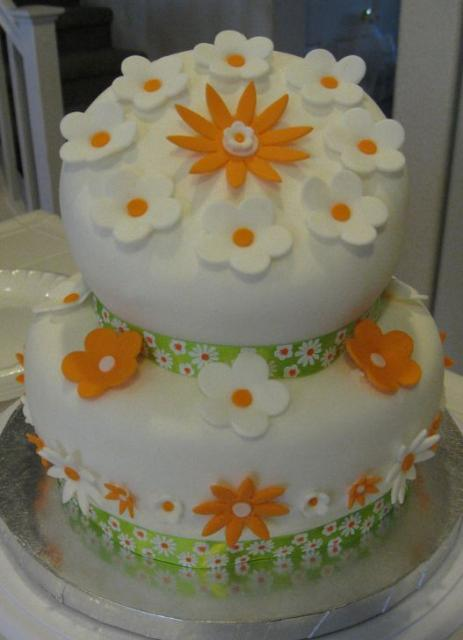 Two Tier Topsy Turvy Round White Cake With Orange And