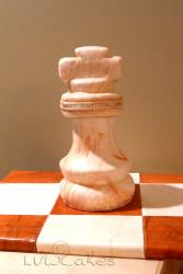 Cool chess piece birthday cake with chess board.JPG