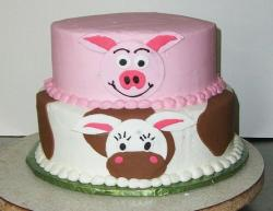 Two tier pink and white pig and cow cake.JPG