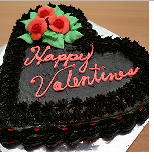Black unique valentine cake with red floral decor.PNG