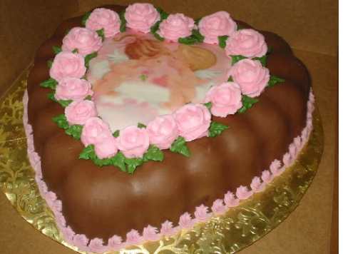 Chocolate valentine cake with a picture of two angles in the center.PNG