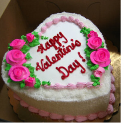 Coco valentine cake with bright pink floral cake decoration.PNG