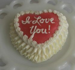 Cute valentine cake with red in the center and white words.PNG